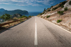 Dividing line on the coastal mountain highway Royalty Free Stock Photo