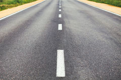 Dividing line on the road. White dividing line on the road surface with the roadside Stock Photography
