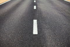 Dividing line on the road Stock Images