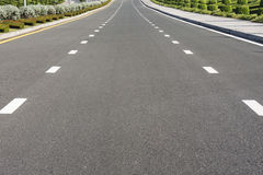 Dividing line on surface road Stock Photos