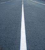 Dividing lines on the highway stock photos