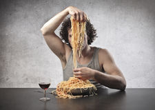 Dividing Spaghetti Royalty Free Stock Photos