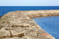 Dividing Wall in the Ocean royalty free stock images