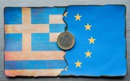 Dividir-se grego da bandeira do Euro fotografia de stock royalty free