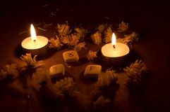 Divination. Elder futhark runes and candles Royalty Free Stock Image