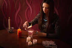 Divination with candle. In room Royalty Free Stock Image