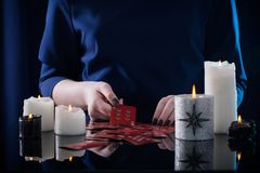 Divination with cards and candles. The divination with cards and candles Stock Photo
