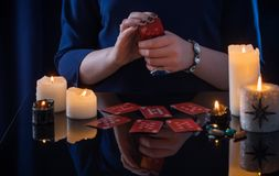 Divination with cards and candles. The divination with cards and candles Royalty Free Stock Photos