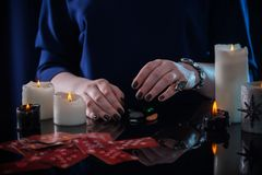 Divination with cards and candles. The divination with cards and candles Royalty Free Stock Image