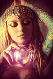 Divination. Magnificent fortune teller holding crystal ball. Divination. Magic. Halloween stock photography