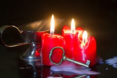 Divination and pouring wax with key and candle. Closeup Royalty Free Stock Photo