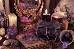 Divination rite with the tarot cards, flowers and mystic objects stock images