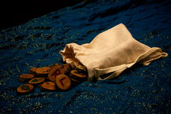 Divination runes on blue cloth Royalty Free Stock Image