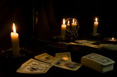 Divination by tarot cards by candlelight, fortune-telling with mirrors stock image