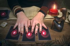 Divination. Tarot cards. Fortune teller. Tarot cards and fortune teller. Future reading concept Stock Image