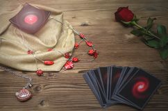 Divination. Tarot cards. Fortune teller. Tarot cards and rose flower on fortune teller desk table background. Future reading. Love or romantic divination royalty free stock image