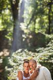 Divine blessing. Couple encircled with sun beams coming from above Stock Image