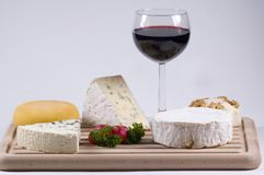 A divine combination. Of cheese and red wine royalty free stock photo