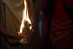 Divine diya holy flame of hindu god worship puja for blessings.  stock photography
