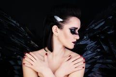 Divine Fantasy. Black Wings and Art Makeup Stock Photos