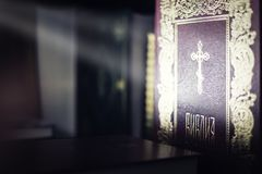 Divine light on russian orthodox holy bible. Religion concept Royalty Free Stock Photos