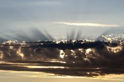 Divine light shining from behind the clouds Stock Images