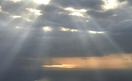 Divine light sky. Evening sky above the sea, with divine rays of light royalty free stock photos