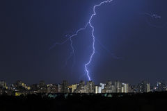 Divine Light, storm is coming. Sky with lightning bolt and silhouette of a cityscape Royalty Free Stock Photos