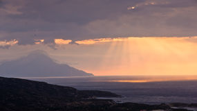 Divine light, stormy sky and sunrise on a landscape around saint mountain Athos Royalty Free Stock Photo