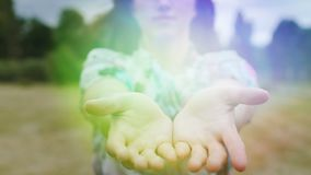 Divine light in woman hands, God's gift female shares magic illumination wonder. Stock footage stock footage