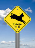 Divine Sign, Leaping Lamb Psalm 18:29. A Divine Sign featuring a yellow diamond-shaped sign in the heavens, depicting a lamb leaping over the words Psalm 18:29 Royalty Free Stock Image