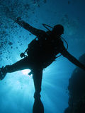 Diving. Underwater diver in back-light (and bubbles Stock Images