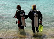 Diving. Divers in wet suit ready to go diving on Bonaire Stock Photos
