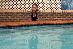 Diving in. Girl jumping in the water Stock Photography