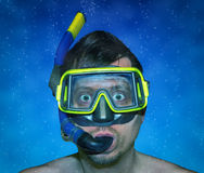 Diving. Man with snorkel and scuba mask, eyes wide open Stock Images