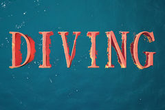 Diving. Advertising plate inscription diving oranzhzhevye letters on background of sea water royalty free illustration