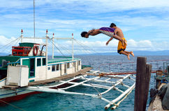 Diving Asian boys in port royalty free stock photography
