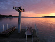 Diving board. Ruin of a diving-board on a silent lake stock photos