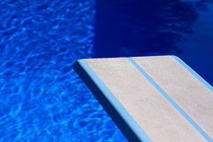 On the Diving board. Summer time: what about a dive into the water royalty free stock photo