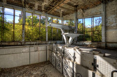 Diving board in Asure swimming pool in Pripyat (HDR) Royalty Free Stock Image