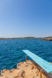 Diving board into sea Stock Images