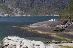 Diving board and stone lounge chairs on natural bathing platform on a sunny day, Eidfjord, Hordaland. Hardanger, Norway, Scandinavia, Europe Stock Photo