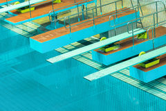 Diving boards in the swimimg pool. Royalty Free Stock Image