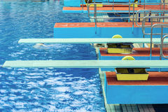 Diving boards in the swimimg pool. Stock Images