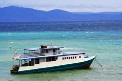 Diving boat. Wooden live aboard diving safari boat in blue sea royalty free stock photo
