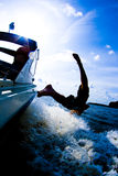 Diving from boat 4. A person is diving from a speeding boat Stock Image