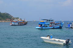 Diving boats take tourists to. April 8, 2014 boats take tourists to snorkeling at Koh Tao Surat Thani, Thailand Royalty Free Stock Photo