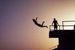 Diving boy. Some teenagers are diving in Malta Stock Photos