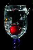 Diving of the cherry. In water Royalty Free Stock Photos