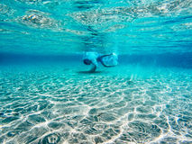 Diving in clear blue water Stock Photos
